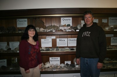 Staff member reorganizes geology exhibit