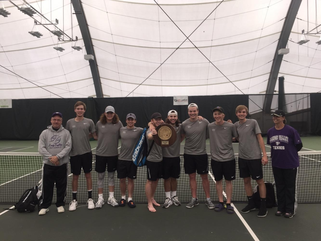 IVCC+Tennis+Team+poses+with+their+hardware+after+a+Regional+victory.