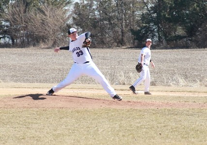 Levi Ericson (33), who played high school ball at La Salle-Peru Township High School, delivers a pitch against Highland Community College on April 2. Ericson is batting .295 and has a 3-1 record when pitching for the Eagles.