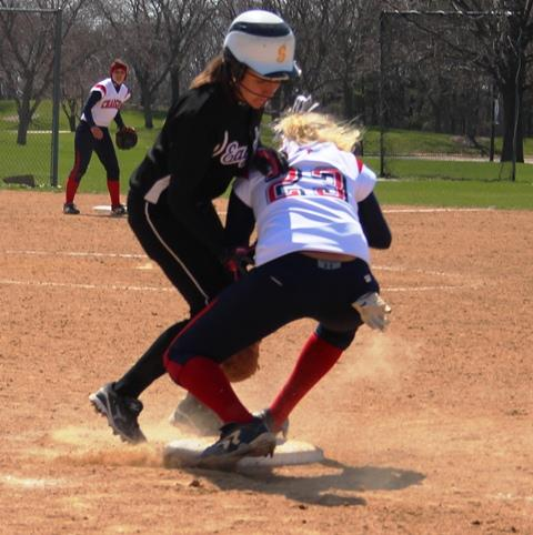 IVCC's Katie Huss (left) makes contact with Augusta Chandler (23) during the seventh inning of a game against Carl Sandburg College on April 21. Huss was ruled to be safe on the play after the ball was knocked away from Chandler. The momentum of this play allowed IVCCto tie the game and force extra innings, although eventually the Lady Eagles fell to the Lady Chargers 7-5.