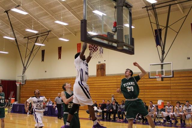 A men's player goes in for a dunk vs. the Illinois Wesleyan JV team.  The Eagles lost 74-61