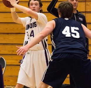 Nick Harsted, a baseball player from Ottawa who has recently joined the Eagles men's basketball team, looks to pass the ball inside during the team's Jan. 21 game vs. St. Ambrose JV. The Eagles won 81-60 and Harsted finished with eight points.