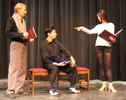 "Director Don Grant Zellmer (left) works with cast members Alex Guerrero and Emily Hanck as they prepare for the musical ""Gypsy."""