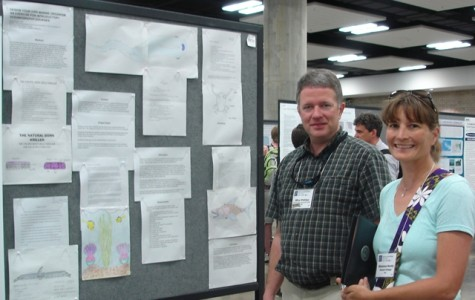 Mike Phillips presents a poster at the event.