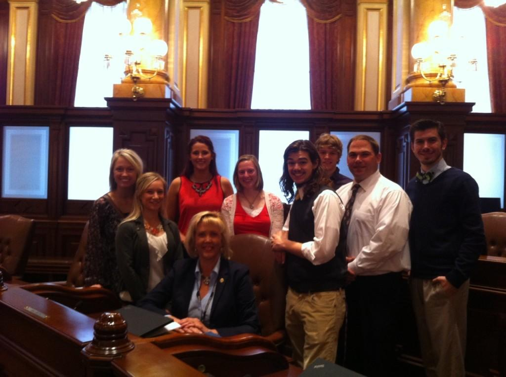 Johnna Schultz (from left), Taylor Gunia, Nicole Musselman, April Kutz, Christian Bender, Tiernan Ebener, Advisor Cory Tomasson and Max Halm meet with state Sen. Sue Rezin on the Senate floor in Springfield on April 2 to lobby for increased funding towards the Monetary Assistance Program grants. Students from throughout the state took part in this Illinois Student Assistance Commission event.