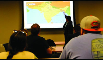 Abhijeet Bhattacharya gives a demonstration to the students participating in his Cultures of India presentation.