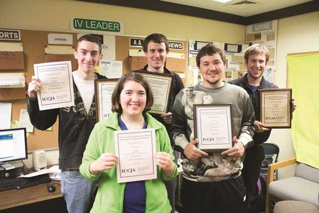 IV Leader staff members display some of the awards won at the April 4-5 journalism conference at Moraine Valley Community College.