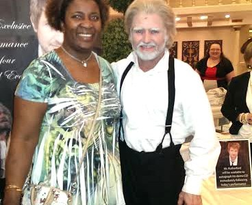 "IVCC student Yvette Lucas takes her picture with star of ""Les Miserables"" Ivan Rutherford."