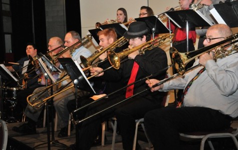 """The trombone and horn sections rehearse for a performance of the IVCC Jazz Ensemble. The group, directed by Tim Karth, will host a free concert at 7:30 p.m. Tuesday, May 6, in IVCC's Cultural Center. The concert will be a tribute to Swing and will include famous tunes, such as """"In the Mood"""" """" and April in Paris."""""""