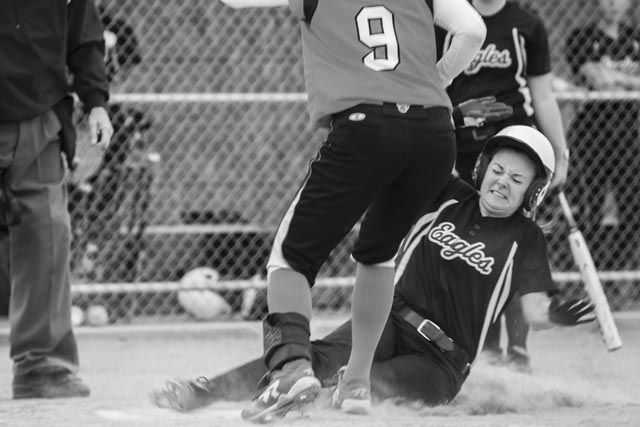 IVCC's Chrissy Pond of Ottawa slides into home plate after a pass ball during one of the Eagles' home games this season.