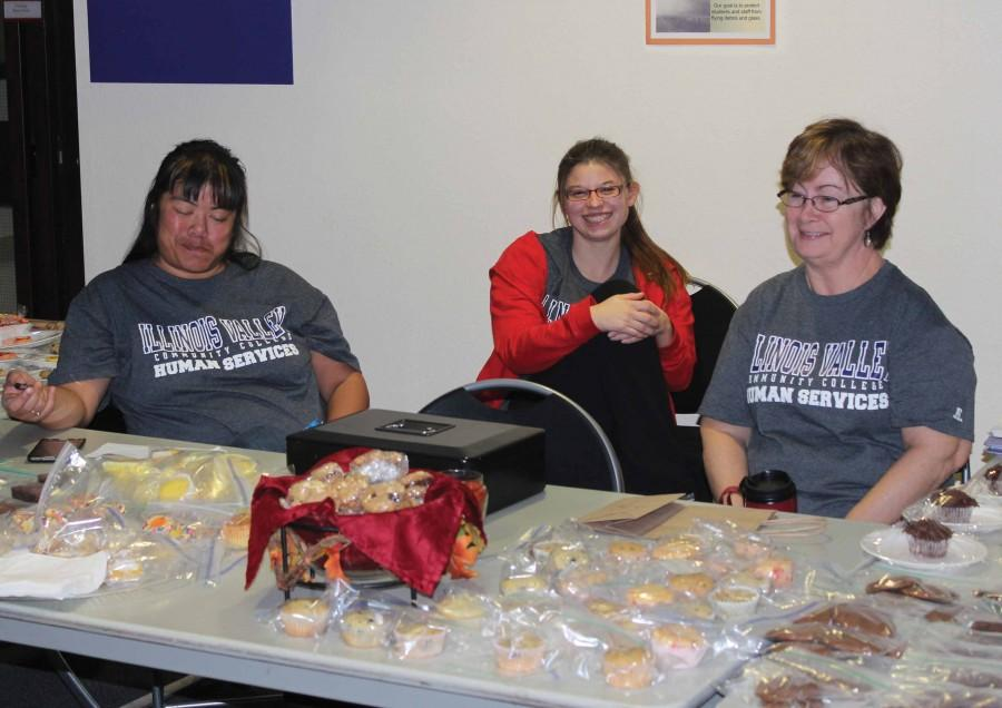 Project Awareness members Jill Nickelsen (left), Morgan Corbel, and Mary Salz man the bake sale table in the IVCC cafeteria on Nov. 2.