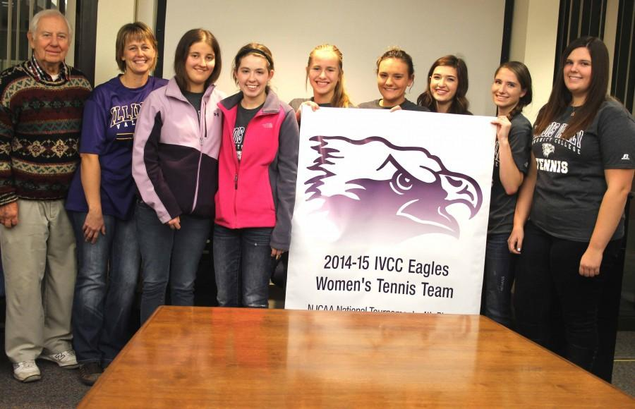 Women's tennis team members were presented with a banner commemorating their 4th place in the NJCAA Division III national tournament in Rolling Meadows, New York. They are Lyle Guenther, assistant coach (left), Julie Milota, head coach, Ashley Ainsley, Katie Wellner, Kayla Guenther, Bianca Sutton, Carly Haywood, Tara Ketner and Kaylee Sienza. The banner will hang in the gym.