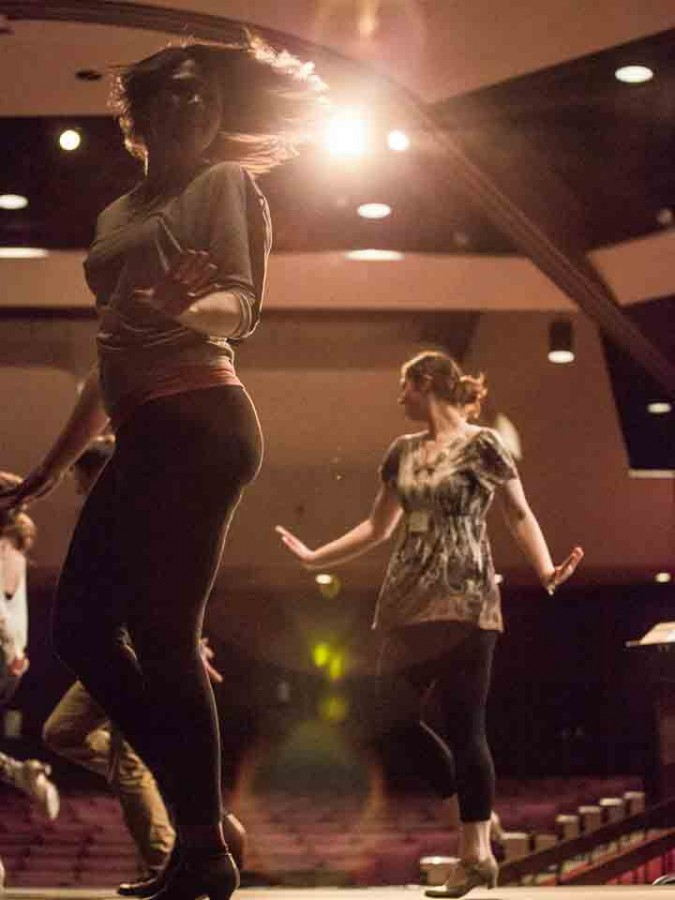 Chelsea Berg (left) and Clarissa Gerrard (right) spin during the dance portion of the auditions for the musical