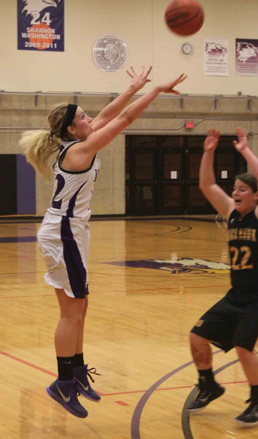 Karly Near shoots a three pointer over a Black Hawk defender in the Eagle's loss.