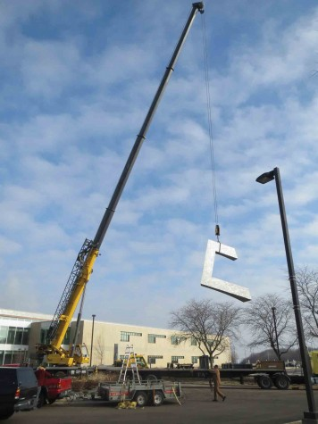 A crane lifts the final piece of the sundial sculpture, which fit together much like a puzzle, on Dec. 19. The artwork was shipped in separate parts to ensure for safer transportation.