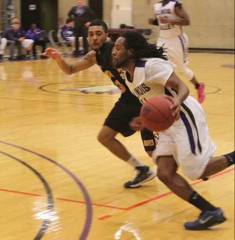 IVCC men's basketball player Jazz Drane drives the ball past the Black Hawk defender. The Eagles would fall in the end by three; 66-69.