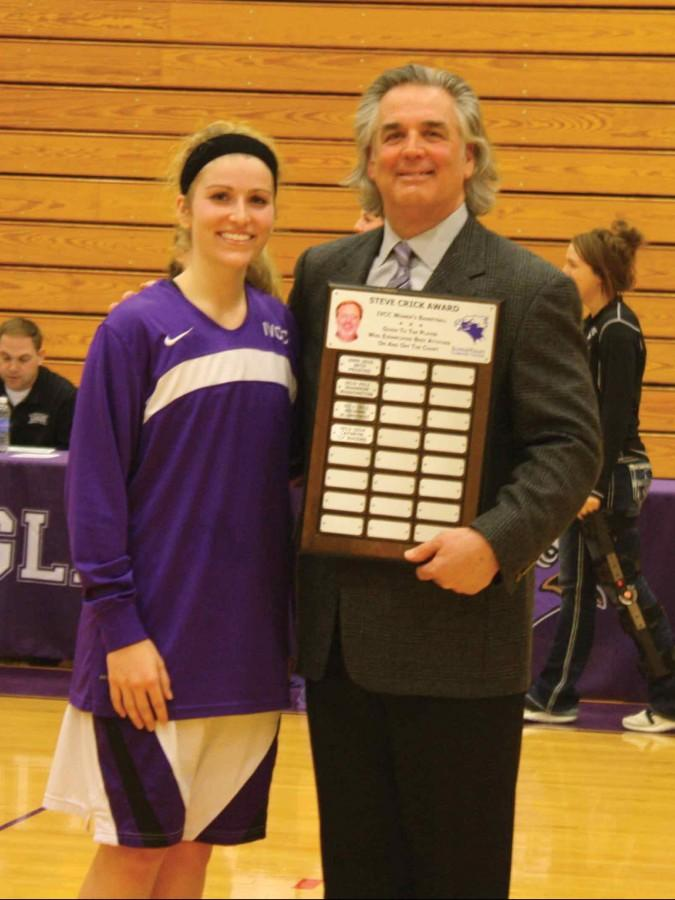 IVCCSophomore KarlyNear accepts the SteveCrick memorial award from Coach Tom Ptak. Near won the award due to her sportsmanship, GPA, positive attitude, and involvement in the classroom and community.