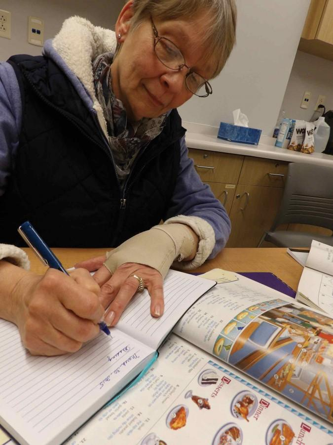 Mary Alice Steck of Hennepin works out a lesson plan for an upcoming tutoring session. Though she retired from the classroom some years ago, she turned her gift for teaching in another direction as an I-READ tutor.