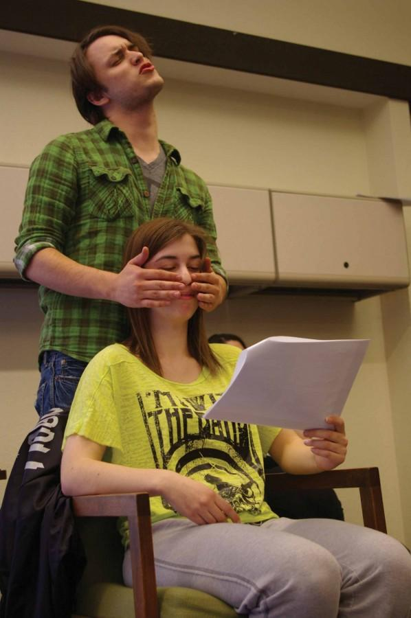 Leighton Williams (seated) teaches Jacob Jakielski about seeing the world without sight in a touching sketch that drew an enthusiastic applause from the rest of the troupe during rehearsal.