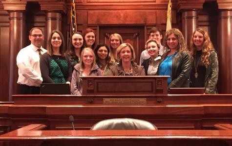 SGA Advisor Cory Tomasson(from left), Sara Lipton, Lexi Scapaci, Katie  Destri, Kaitlin Raneiri, Vanessa Olivares, Ellen Herrmann, Sen, Sue Rezin, Sarah Mckeen, Cody  O'Brien, Elizabeth Gonzalez, Becca Herrmann visit in the Illinois Senate chamber.