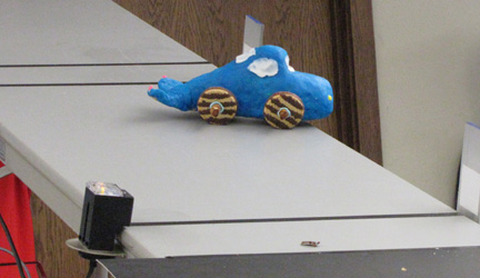 Many cars, like this whale inspired vehicle made of fondant, don't even make it down the ramp.