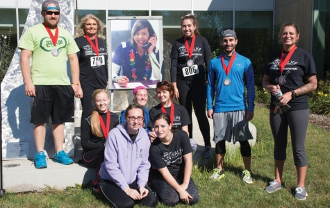 2016 5K winners pose with a picture of Skerston. This year's event will take place Oct. 14. Runners, walkers and volunteers are needed.