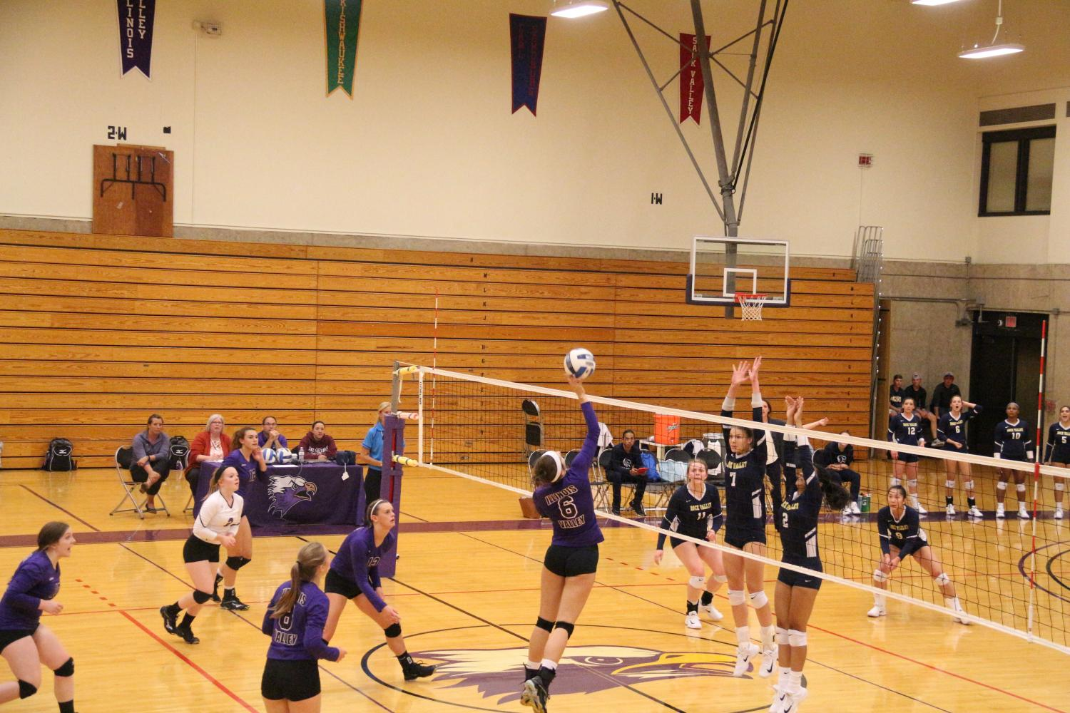 Freshman outside hitter Kaitlyn Edgcomb looks to spike it home against Rock Valley.