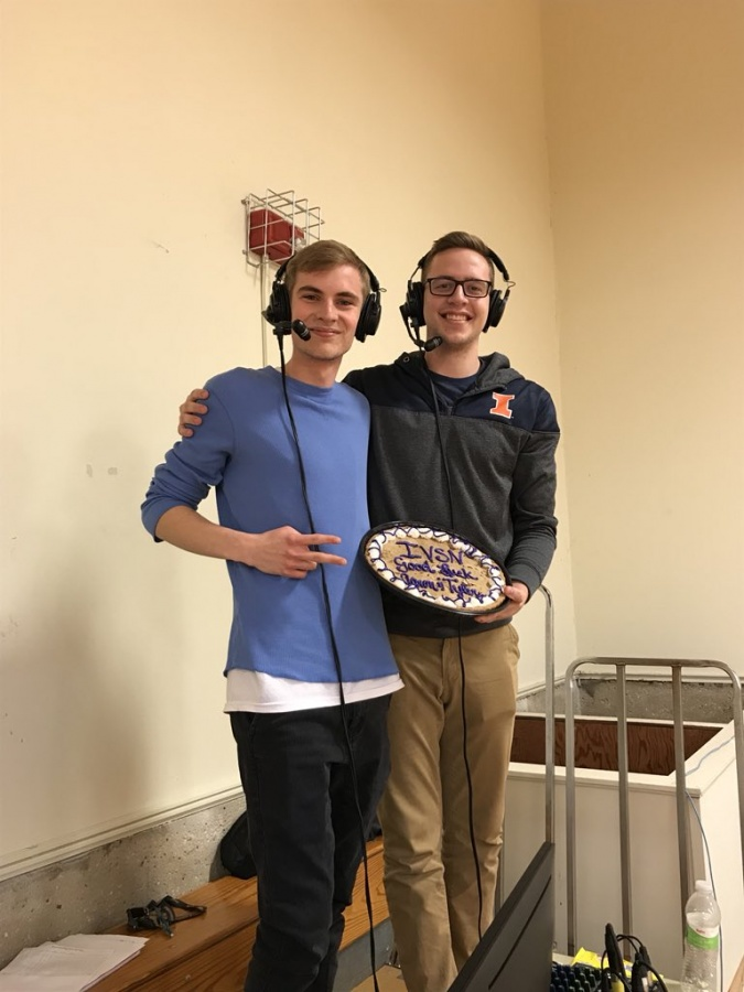 Sweet sendoff Aaron Pellican (left) and Tyler Towne enjoy a cookie cake during one of their last home broadcasts for the Illinois Valley Sports Network.