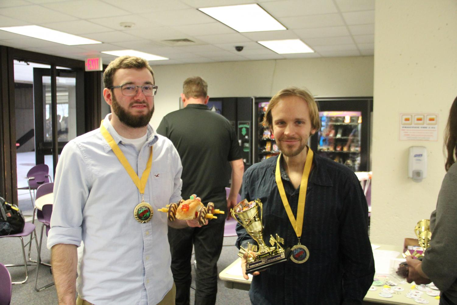 Entirely edible Ben Ross and Lewis Habben (top photo), CAD students, won first place in the speed competition during the Feb. 28 Edible Car Contest in the IVCC cafeteria.