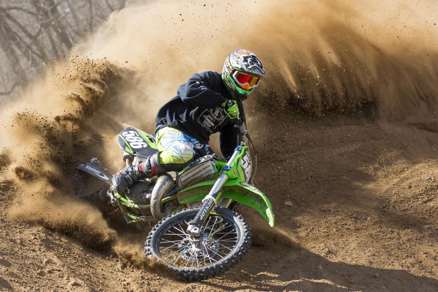 Joey Brewer of Ottawa washes out a berm on his Kawasaki KX125 while taking a high speed corner during practice at Fox Valley Off-Road on March 25, 2018. Brewer, a former top A class rider has been riding motocross since age ten.