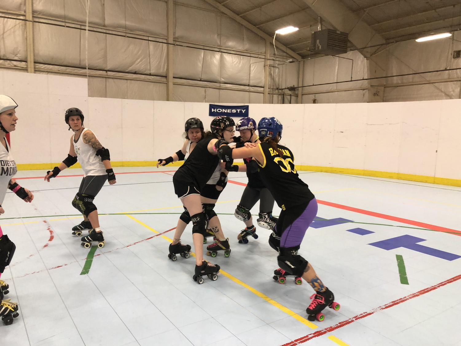 Barbed Wire Betties practing a braced-wall drill in Sycomore. Pictured from left to right, Demon, Slaughtermelon, Millennial Falcon and TsumAmy.