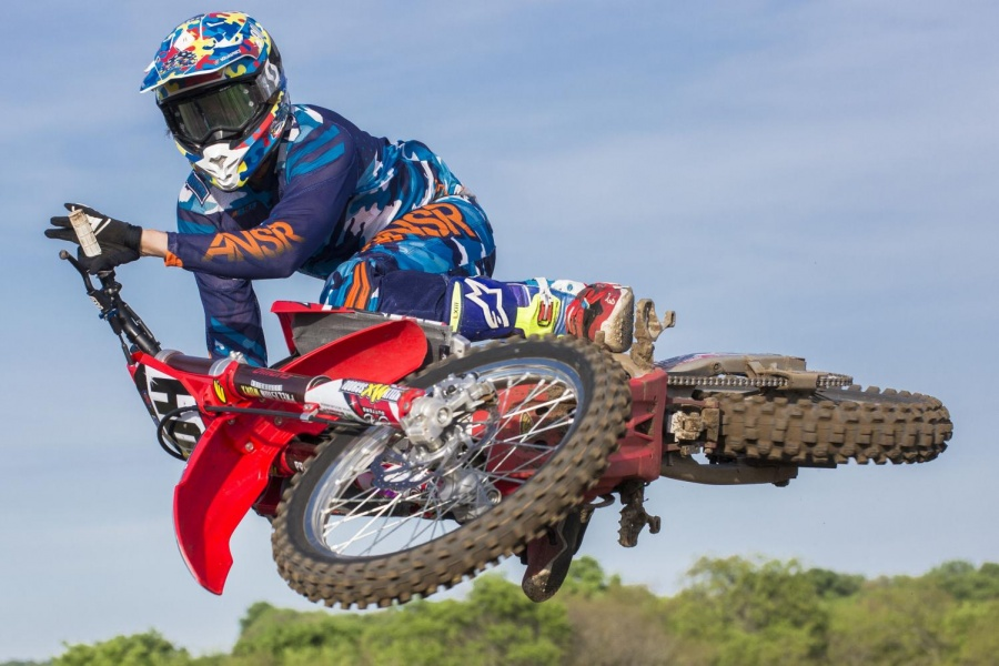 Motocross rider Justin Kelly demonstrates a technique called scrubbing, which involves riding his bike completely sideways midair to achieve the best possible aerodynamics. Kelly has been riding his whole life and now dedicates his time to training the youth of the sport.
