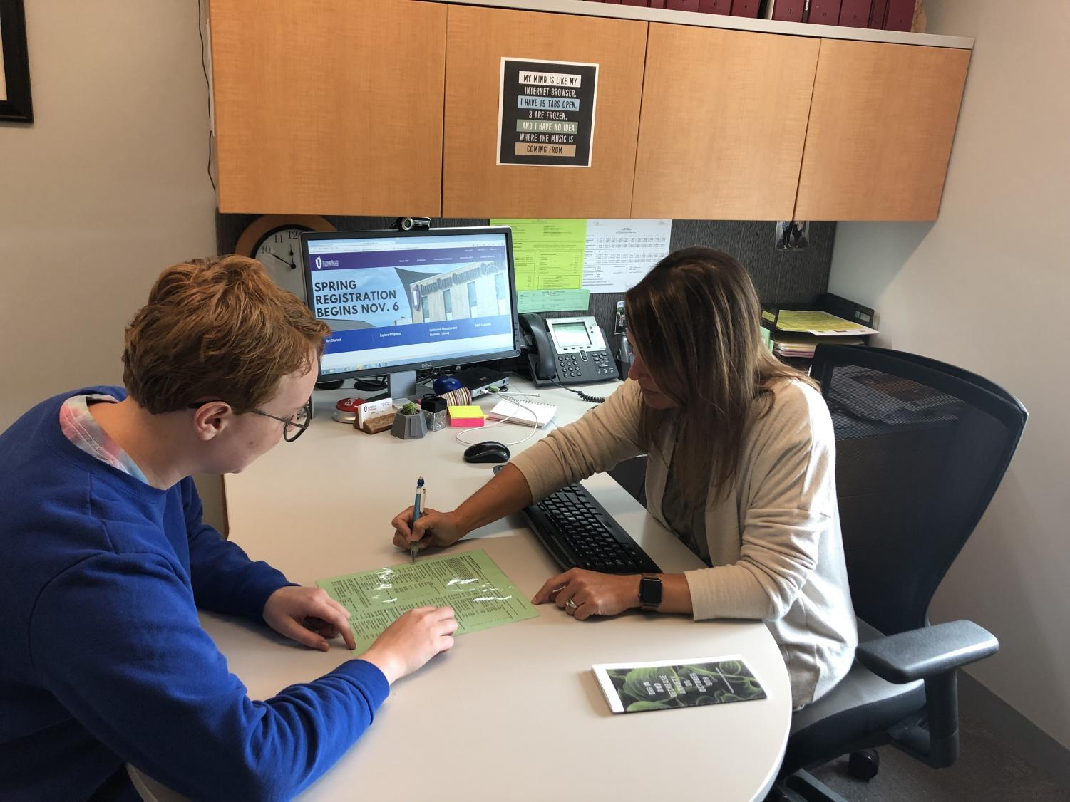 Renee Prince, an IVCC counselor, meets with student Claire DeGraaf to set up her spring schedule.