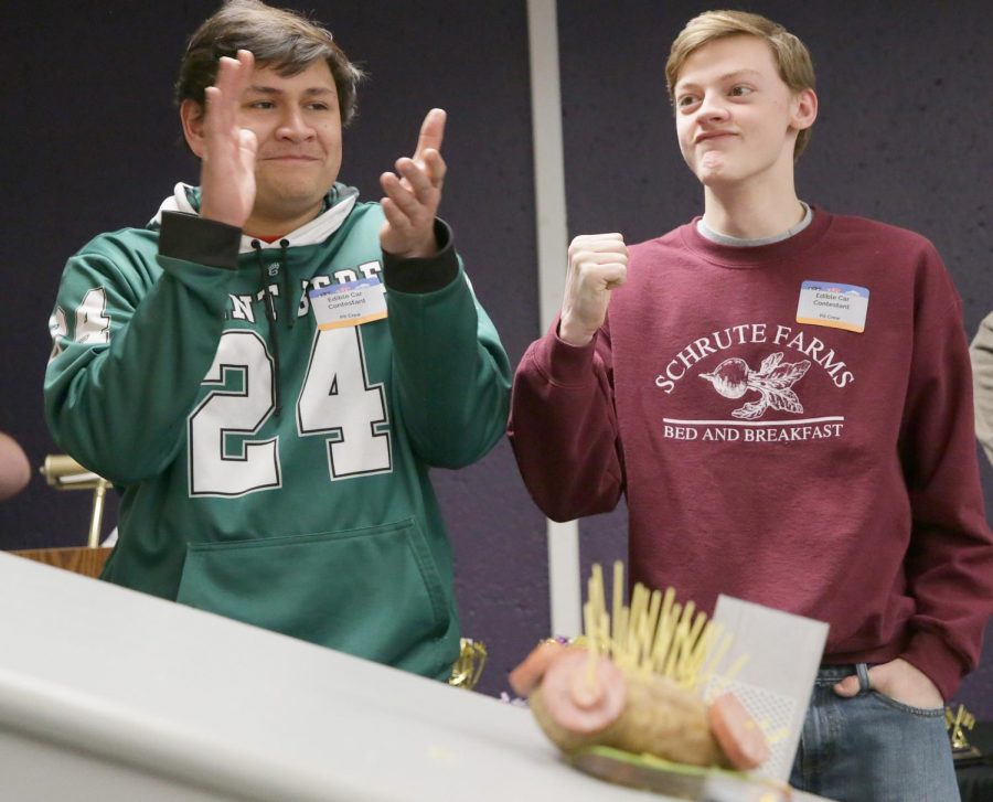 Two+students+from+St.+Bede+are+enjoying+the+edible+car+contest