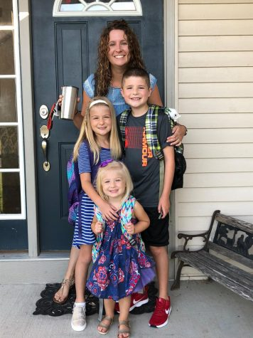 Naomi Pickens and her three children ready for their first day of the school year.