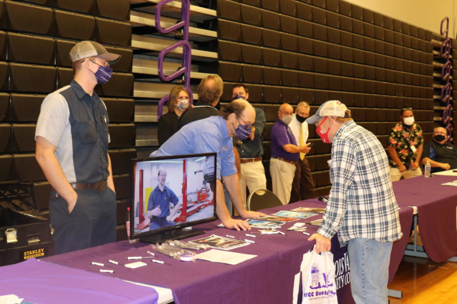 Art Koudelka speaks to an attendee of College and Career Night